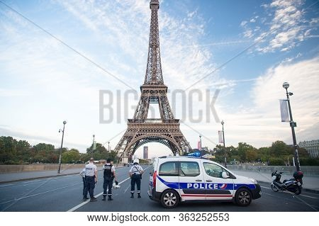 Paris, France - September 29, 2017: Roadblock On Eiffel Tower Background. Police Officers And Patrol