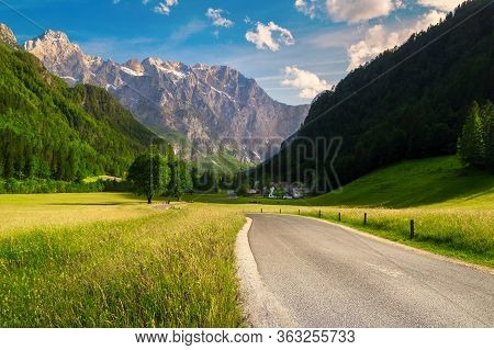 Beautiful Summer Alpine Landscape, Flowery Meadows And High Snowy Mountains At Sunset, Logar Valley