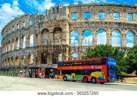 Pula, Croatia - June 15, 2015: Popular Travel Destination With The Famous Roman Amphitheatre (arena)