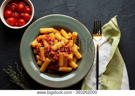 Tasty Appetizing Classic Italian Pasta With Tomato Sauce, Parmesan Cheese And Noodles On A Plate On