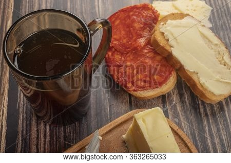 Fresh Wheat Toast With Butter, Sausage And Cheese, A Wooden Butter Dish With A Piece Of Butter And A