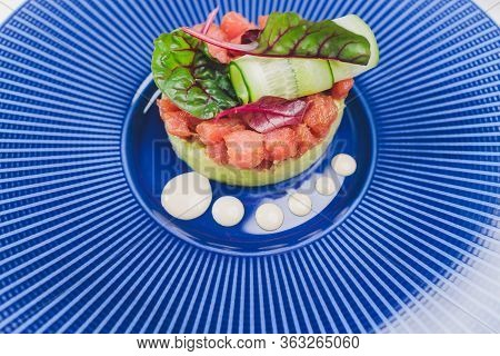 Ceviche Of Seabass And Salmon With Finely Cut Vegetables.