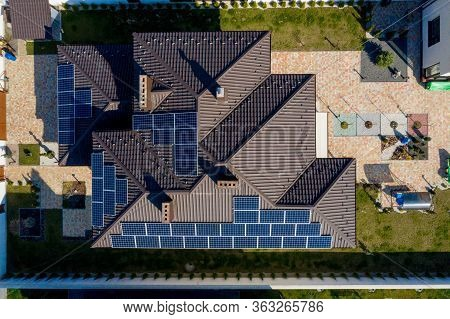 New House With Garden And Solar Panels On The Roof