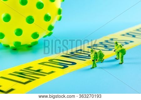 Closeup Of One Big Virus With Waiting In Front Of Do Not Cross Line And Special Medical Biohazard Te