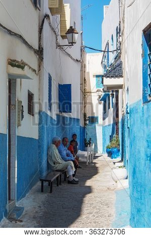 Rabat, Morocco - Oct 13, 2019: Men Sitting On The Street Of Rabat, Morocco. Rabat The Capital And Se