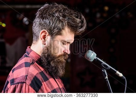 Talented Vocalist Concept. Musician, Vocalist With Beard And Mustache Lighted By Spotlight. Man On C