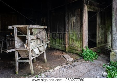 A View Of An Old Wooden Machine Taken In An Abandoned Village In A Forest Near Yangshuo, China