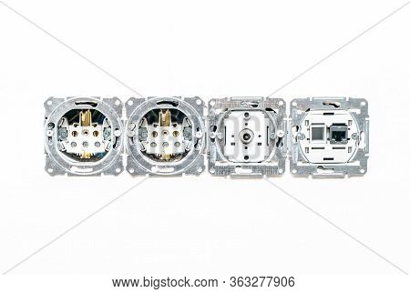 Internal Sockets Without Frame Against A Background Of White Plaster Wall