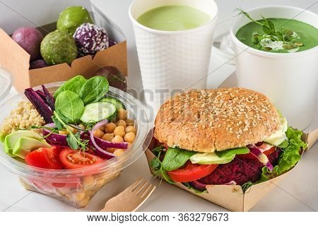 Healthy Vegan Food Delivery. Packed Burger, Buddha Bowl Salad, Green Soup, Energy Balls And Matcha L