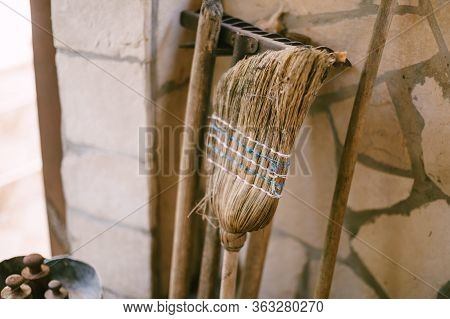 An Old Broom. Old Broom, Half Erased. Tools For Cleaning The Yard - Broom, Rake And Shovels