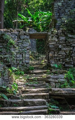 A Pathway Of Concrete Steps Among Old Abandoned Houses Of An Old Village Located In The Middle Of Th