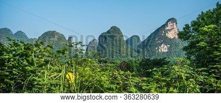 Beautiful Green, Lush And Dense Karst Mountain Landscape In Yangshuo, Guangxi Province, China