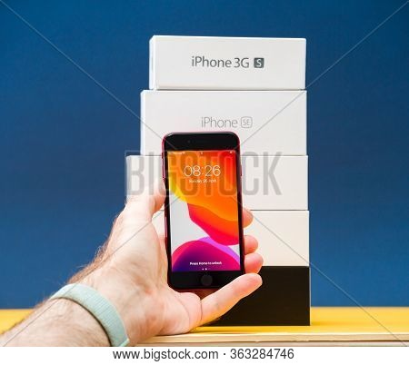 Paris, France - Apr 26, 2020: Hand Holding New Budget Iphone Se By Apple Computers Touch Id, Single-