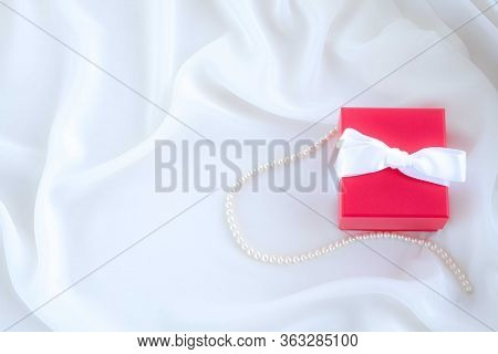 Present For Anniversary Or Bithday Or Valentines Day Or Christmas. Red Gift Box With Wite Bow On Whi