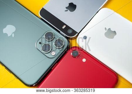 Paris, France - Apr 26, 2020:four Smartphones 11 Pro, 2016 Se, 3gs Next To New Budget Iphone Se By A