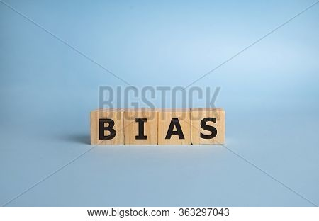 Bias - Word From Wooden Blocks With Letters, Personal Opinions Prejudice Bias Concept, Blue Backgrou