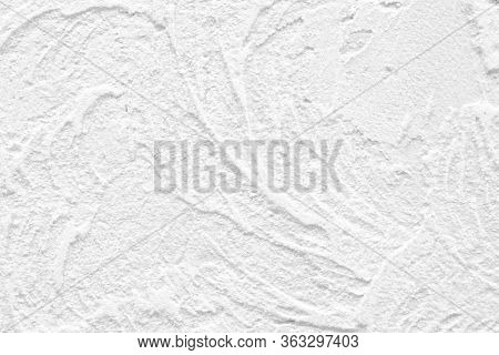 The Background Of The Raised White Wall Is Finished With Decorative Plaster. Abstract Streaks Like W