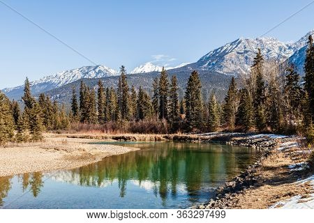 Clear Blue Sky And River In East Kootenay British Columbia Canada.