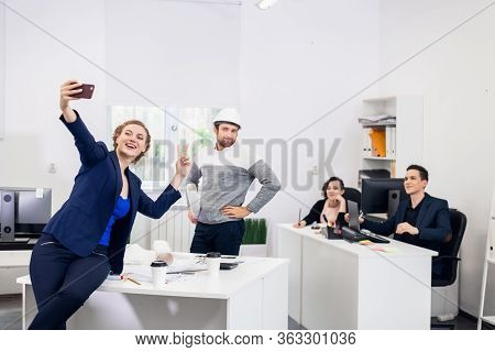 After Hours In The Office. Employees Having Fun After A Hard Wor