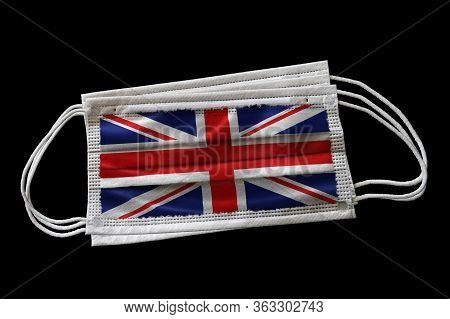 3d Rendering Of Surgical Face Masks With Uk Flag Printed. Isolated On Black Background. Concept Of F