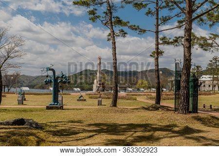 Jinan, South Korea; April 21, 2020: Welded Metal Sculptures At Yongdam Dam Reservoir Park With Tall