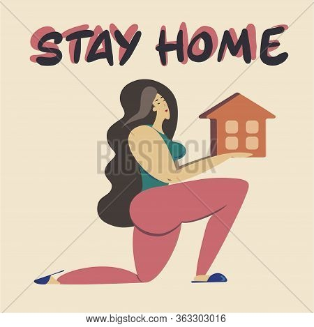 Stay At Home. A Girl Holds A House In Her Hands.a Call To Stay Home During The Pandemic. Quarantine,