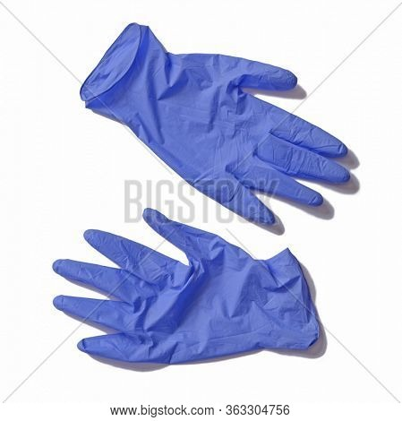 Surgery doctor gloves after use isolated on white background.