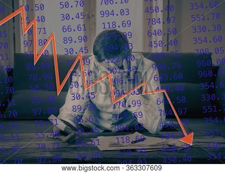 Covid-19 Global Economic Recession. Desperate Entrepreneur Stock Trader Calculating Loss Affected By