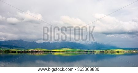 Lake In Mountains. Cloudy Day In Springtime. Beautiful Scenery Of High Tatra Mountains In Dappled Li