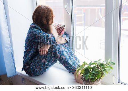 Coronavirus, Covid-19, Quarantine, Isolation, Coronavirus Pandemic World. Stay At Home. Bored Woman