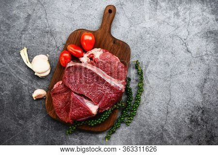Fresh Beef Animal Protein / Raw Beef Meat On Wooden Cutting Board On The Kitchen Table For Cooking B
