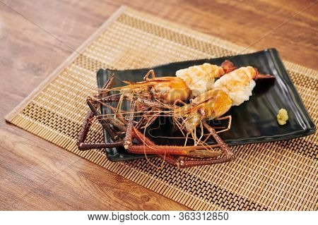 Plate With Delicious Cooked Spiny Lobsters On Bamboo Napkin