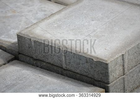 Stack Of Gray Paving Slabs. Laying The Sidewalk Of The Tiles. Construction Of Sidewalks. Building Ma