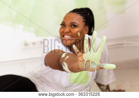 Funny Afro American Woman Painting An Apartment. Renovation, Repair And Redecoration Concept.