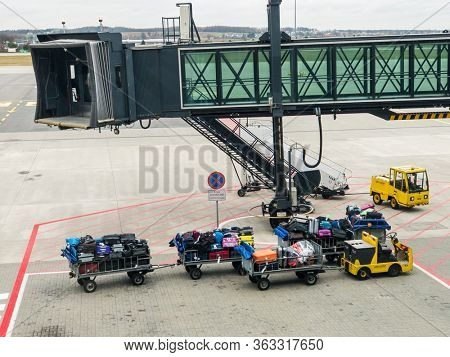 Zurich, Switzerland - July 19, 2018: Loader carries passengers luggage at the airport