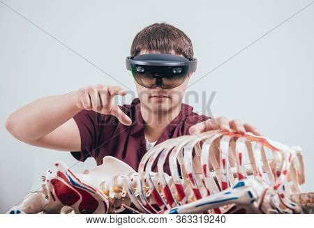 Doctor Uses Augmented Reality Goggles To Exam Human Skeleton.