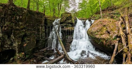 Huge Waterfall In The Forest. Multiple Cascade Of The Water. Beautiful Nature Scenery In Springtime