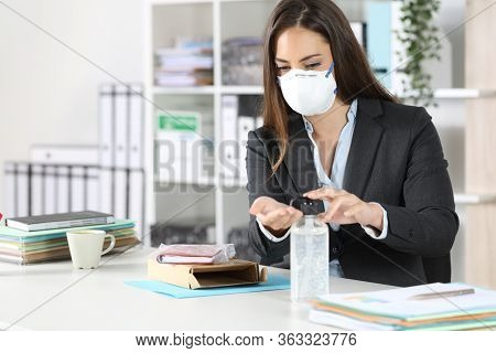Executive Cleaning Hands After Open A Package Avoiding Coronavirus Contagion At Office