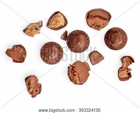 Creative Layout Made Of Chocolate Praline Candies  Isolated On White Background. Candies Collection.