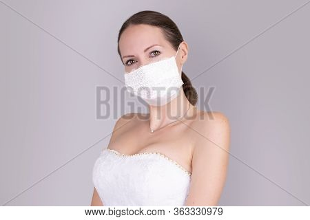 Beautiful Young Bride In A Wedding Dress And A White Medical Mask On Face
