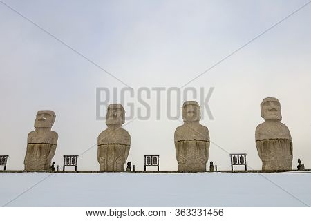 Sapporo, Hokkaido, Japan - December 2019 : Moai, Big Stone Statue In Winter With Snow On Ground At H
