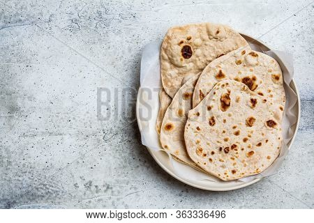 Homemade Indian Pita Chapati On A Gray Background. Vegetarian Cuisine Concept.
