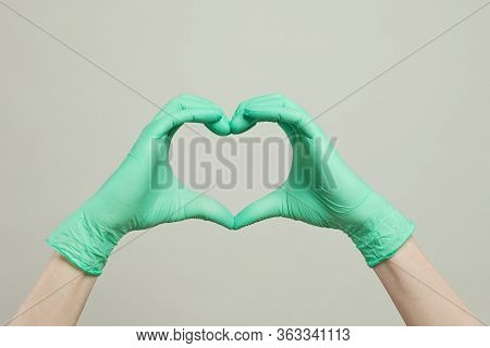 Heart Of Doctor Gloves Hands. The Heart From The Hands In Medical Gloves On White Background