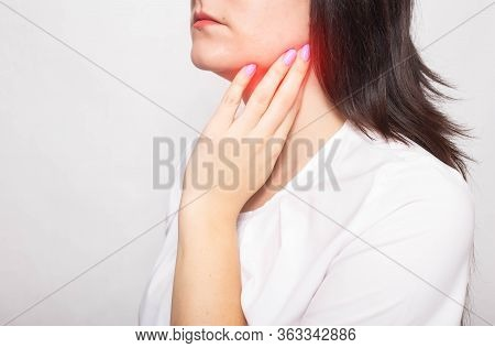 The Girl Clings To The Inflamed Salivary Gland In Which Pain. Concept Of Salivary Gland Disease, Mum