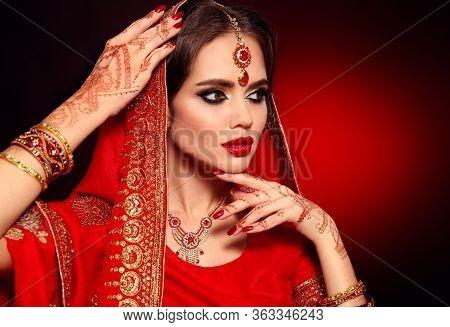 Portrait Of Beautiful Indian Girl In Red Bridal Sari. Young Hindu Woman Model With Kundan Jewelry Se