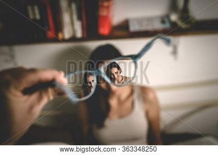 Beautiful Woman Portrait Through Eyeglasses. Woman Photographed Through Eyeglasses. Hipster Lifestyl