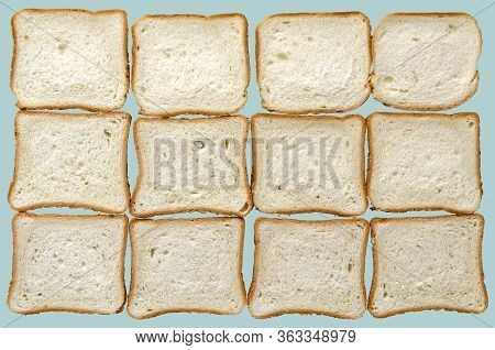 Toast Bread Background. Twelve Slices Of Sliced Bread On A Turquoise Background. Rectangular Slices