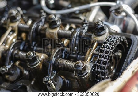 A Detailed Shot Of The Cylinder Head Of A Carburetor Engine. Four-stroke Gasoline Engine Without Cov