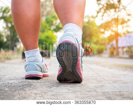 Running Sport. Man Runner Legs And Shoes In Action On Road.
