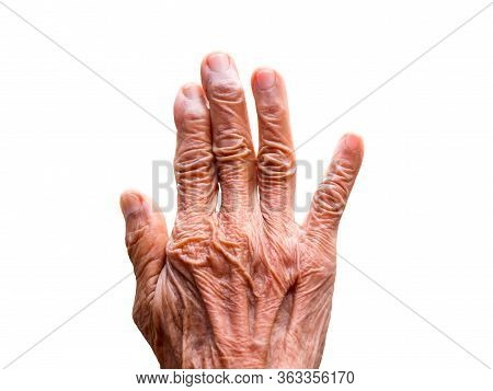 One Hand Of An Elderly Woman Isolated On White Background. Senior Lady Wrinkled Hand.